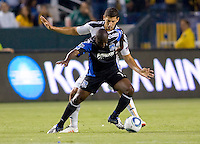 LA Galaxy defender Omar Gonzalez (4) defends against San Jose Earthquake forward Cornell Glen (13). The LA Galaxy and the San Jose Earthquakes played to a 2-2 draw at Home Depot Center stadium in Carson, California on Thursday July 22, 2010.