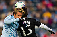 Chance Myers (7) of Sporting Kansas City and Gabriel Farfan (15) of the Philadelphia Union battle for a header during the first half during a Major League Soccer (MLS) match at PPL Park in Chester, PA, on March 2, 2013.