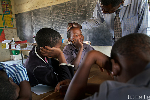 Grade six (age 11 - 12) children at the Mutenda Primary School in drought-hit Masvingo Province, Zimbabwe, collapse from hunger and exhaustion during class. <br /> <br /> Drought in southern Africa is devastating communities in Zimbabwe, leaving 4 million people urgently in need of food aid. The government declared a state of emergency,. <br /> <br /> Here in Masvingo Province, the country's hardest hit province, vegetation has wilted, livestock is dying, and people are at serious risk of famine. <br /> <br /> Pictures shot by Justin Jin