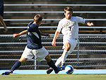 2 September 2007: Wake Forest's Cline Beam (7) pushes past Monmouth's Rich Baker (l). The Wake Forest University Demon Deacons defeated the Monmouth University Hawks 2-0 at Fetzer Field in Chapel Hill, North Carolina in an NCAA Division I Men's Soccer game.