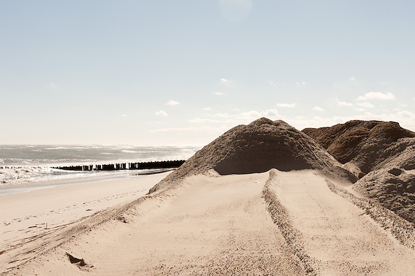 February 27, 2013. Holgate, New Jersey. A the end of the beach, the city and state have set up an area to clean rubble out of all the sand they have collected from city streets during Hurricane Sandy cleanup. The sand will be redeposited on the beaches to replace what was lost.. Tracing the path of Hurricane Sandy, which wrecked havoc on the northeastern seaboard from October 25-31, 2012. The storm caused flooding and caused an estimated 60 billion dollars worth of damage to affected areas.