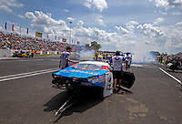 Jun. 2, 2013; Englishtown, NJ, USA: NHRA crew members for pro mod driver Mike Janis during the Summer Nationals at Raceway Park. Mandatory Credit: Mark J. Rebilas-