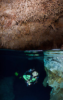 RX0776-D. scuba diver (model released) explores a cavern with an air dome. This underground chamber is decorated above and below the waterline with beautiful stalactites, stalagmites and columns, delicate limestone formations created over millions of years. Riviera Maya, Yucatan Peninsula, Mexico.<br /> Photo Copyright &copy; Brandon Cole. All rights reserved worldwide.  www.brandoncole.com