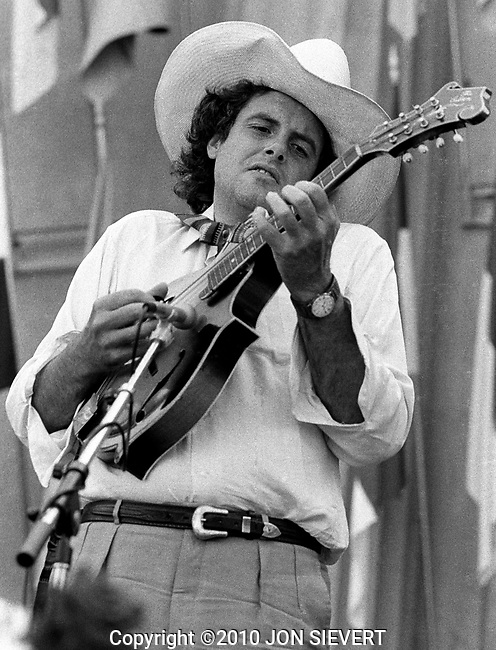 Peter Rowan, Bread & Roses Festival  9/3/78, 37-7-24A Greek Theater, Berkeley, CA, American bluegrass musician and songwriter. Rowan plays guitar and mandolin, yodels and sings. Rowan teamed up with David Grisman in 1967 forming the band Earth Opera which frequently opened for The Doors. In 1969, Rowan joined Seatrain, along with Richard Greene.[6] In 1973, Rowan, together with Greene, Grisman, Bill Keith, and Clarence White formed the bluegrass band Muleskinner. The band released one album. The same year, (1973), Rowan and Grisman formed Old and in the Way with Greene, Jerry Garcia, and John Kahn.