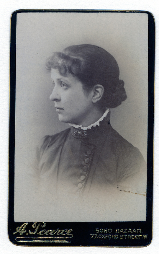 4a.<br /> <br /> 3 9/16  x  2 5/16  [sepia]<br /> 4 1/8  x  2 1/2  [card stock]<br /> <br /> Sarah H. Voegtly  (head tipped, 2 of 2)<br /> ca 1885, at time of marriage<br /> mounted on heavy card stock<br /> <br /> recto<br /> A. Pearce<br /> SOHO BAZAAR<br /> 77 OXFORD STREET W [London]<br /> <br /> From the Steiner photograph album.<br /> <br /> It is difficult to know if there are two different photographs, or if they are mounted differently.