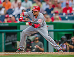 21 May 2014: Cincinnati Reds outfielder Billy Hamilton lays down a bunt against the Washington Nationals at Nationals Park in Washington, DC. The Reds edged out the Nationals 2-1 to take the rubber match of their 3-game series. Mandatory Credit: Ed Wolfstein Photo *** RAW (NEF) Image File Available ***