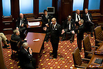 Sergeant-at-Arms Joe Agans-Dominguez, center, briefs security staff before the start of the second day of Gov. Rod Blagojevich's Senate impeachment trial at the Illinois State Capitol in Springfield, Ill..Kristen Schmid Schurter