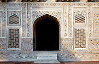 "Agra, India.    Entrance to the Itimad-ud-Dawlah, Mausoleum of Mirza Ghiyas Beg.  The tomb is sometimes referred to as the ""Baby Taj.""  It is one of the finest examples of pietra dura work, making designs through the use of inlaid colored stone."