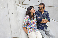 Contemporary artist husband-and-wife Subodh Gupta and Bharti Kher in Gupta's recently completed studio in the Delhi-satalite town of Gurgaon...Gupta's most celebrated sculptures are constructed from common domestic items including the steel pots and pans that are a feature every Indian home. Of the kitchen-ware that forms the basis of his work, Gupta says,..&quot;The poor, the middle class and the rich use it at home. In this country, how many people have the utensils but they starve because there is no food?&quot;..Gupta was brought up, one of six children, to a railway-worker father in a north Indian village. ..Gupta's work fetches such huge sums of money. Two versions of his Mind Shut Down, modeled on the human skull and constructed entirely of steel kitchen utensils recently sold for EUR1 million each...Photo: Tom Pietrasik.Gurgaon, Haryana. India. .July 23rd 2009