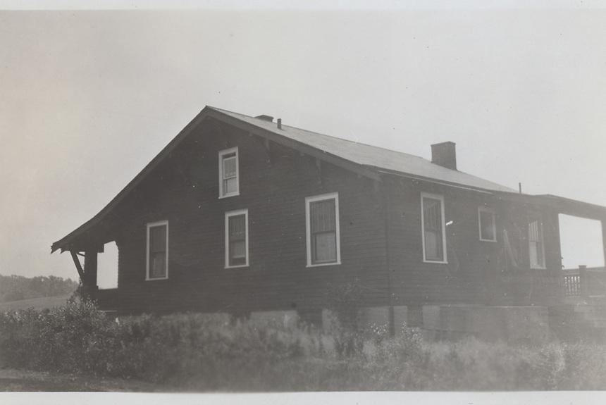Title: Crone's bungalow exterior left corner of back side<br /> Type: Photo<br /> Cat #: 032b.<br /> File Name: 31b.jpg<br /> Formats: original object