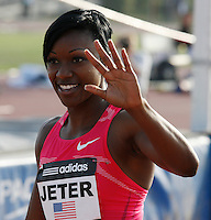 Carmelita waving to the fans after her 100m victory at the Adidas Track Classic 2009 on Saturday, May 16, 2009. Photo by Errol Anderson, The Sporting Image.net