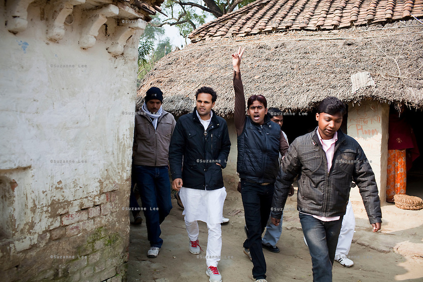 """Minister of Legislative Assembly, Ritesh Pandey, 30, campaigns door-to-door in rural villages with a crowd of supporters chanting slogans such as """"long live Ritesh Pandey"""" and """"press the button, decide the elephant (symbol)"""" in Ajanpara, Ambedkar Nagar, Uttar Pradesh, India, on 21st January, 2012. Returning 1.5 years ago after almost 10 years abroad, Pandey is contesting on behalf of the Bahujan Samaj Party (BSP), a party that is based on its appeal to Dalit (the lowest Hindu caste) voters. Party leader Mayawati, herself a Dalit, has recently been giving out more tickets to muslims and high caste candidates in an attempt to woo a larger spectrum of voters in Uttar Pradesh, a Bellwether state. Photo by Suzanne Lee for The National (online byline: Photo by Szu for The National)"""