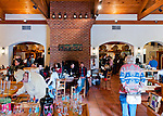 An attractive, spacious, and uncrowded seating and storefront area at the front belies the packed tasting room beyond, at Barboursville Vineyards.
