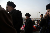 Uighurs walk through a market in the center of the Old City in Kashgar, Xinjiang, China.