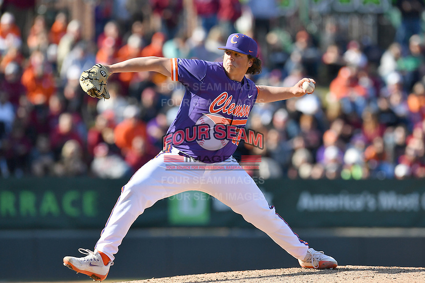 Pitcher Jacob Hennessy (32) of the Clemson Tigers delivers in the Reedy River Rivalry game against the South Carolina Gamecocks on Saturday, March 4, 2017, at Fluor Field at the West End in Greenville, South Carolina. Clemson won, 8-7. (Tom Priddy/Four Seam Images)