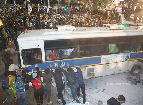 Ferry tragedy protest, Apr 18, 2015 : Protesters try to move a police bus placed by the police to stop their march toward Gwanghwamun gate near the presidential Blue House in Seoul, South Korea. About 30,000 people  (8,000 by police estimate) demonstrated on April 18,  two days after the first anniversary of Sewol ferry tragedy to demand that the government scrap the special Sewol Law enforcement decree, salvage the ferry and hold a thorough investigation into the tragedy. They also called for resignation of President Park Geun-hye.The police detained about 100 protesters during the protest. (Photo by Lee Jae-Won/AFLO) (SOUTH KOREA)