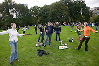 "16 October 2005 - New York City, NY - People following instructions playing on their handheld digital music players dance on one leg in Central Park, New York City, USA, 16 October 2005, during a so-called ""MP3 Experiment"" organized by Improv Everywhere, a group of young artists which seek to organize bizarre, anonymous happenings and pranks."