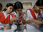Students study biology at the Lucie Harrison Girls High School in Lahore, run by the Church of Pakistan.