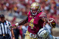 TALLAHASSEE, FLA 9/10/16-Florida State's Dalvin Cook attempts to stretch the ball over the goal line as Charleston Southern's Larenzo Mathis pushes him out of bounds at the one yard line during first quarter action Saturday at Doak Campbell Stadium in Tallahassee. <br /> COLIN HACKLEY PHOTO