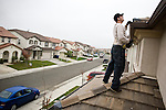 SACRAMENTO, CA - DECEMBER 2:   NorthWoods inspector Manny Nevarez inspects the roof of a foreclosed home for needed repairs in Sacramento, California December 2, 2008. Many foreclosed homes need substantial repairs before going on the market. (Photo by Max Whittaker/Getty Images)