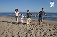 Family holding hands running together on beach (Licence this image exclusively with Getty: http://www.gettyimages.com/detail/83154262 )