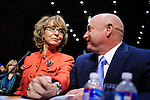 Retired Navy Capt. Mark Kelly, sits with his wife Rep. Gabrielle Giffords as she prepares to make a statement before a Senate Judiciary Committee hearing on gun violence on Capitol Hill in Washington, DC on January 30, 2013. UPI/Pete Marovich