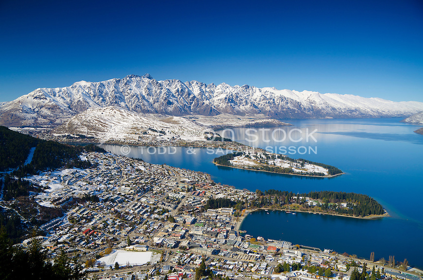 Snow covered Remarkables mountains, with Queenstown and Lake Wakatipu in the foreground, seen from the Skyline Gondola winter, South Island, New Zealand