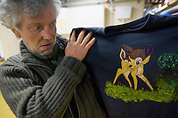 Switzerland. Geneva. Serge is a swiss citizen and a homeless man sleeping at night in the fallout shelter Richemont. He holds in his hands a tee-shirt with his hand-drawing of Bambi's fawn. Bambi, A Life in the Woods, is a novel by Austrian author Felix Salten on which the Disney film is based. The bunker was constructed as civil defense measures during the Cold War and is a unit of the Civil Protection. Switzerland is unique in having enough nuclear fallout shelters to accommodate its entire population. 7.02.2014 © 2014 Didier Ruef
