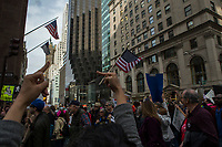 NEW YORK, NY - APRIL 15: Activists raise their middle fingers as they pass near Trump Tower during a Tax Day protest on April 15, 2017 in New York City. Thousands of activists march to Trump Tower to demand that President Donald Trump release his tax returns. Photo by VIEWpress/Eduardo MunozAlvarez