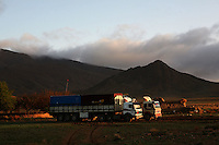 As dawn creeps over the horizon the trucks bathe in the golden sunlight of the morning
