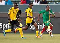 CARSON, CA – June 6, 2011: Greneda player Anthony Straker (15) runs past Jamaicans Dicoy Williams (3) and Jason Morrison (7) during the match between Grenada and Jamaica at the Home Depot Center in Carson, California. Final score Jamaica 4 and Grenada 0.