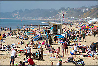 BNPS.co.uk (01202 558833)<br /> Pic: PhilYeomans/BNPS<br /> <br /> Sizzling Sunday - Holidaymakers make the most of the first hot weekend of the year on Bmth beach today.