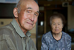 Minoru Oka, 85, poses for a photo with his wife Fukuko, 82 at their home in Minamisoma, Fukushima Prefecture, Japan on Friday 05 August, 2011.  For Oka the nuclear crisis that began almost 5 months ago just down the road from his home  following the March 11 quake and tsunami is his second brush with the threat of radiation. .When the atomic bomb was dropped on Hiroshima on Aug. 6, 1945, Oka was a 19-year-old member of an Imperial Japanese Army unit located in Hiroshima..Photographer: Robert Gilhooly