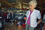 Sister Zita Telkamp surveys donated clothes at the Posada Providencia in San Benito, Texas. Telkamp, a member of the Sisters of Divine Providence, is executive director of the shelter, which provides a safe place for people in crisis from all over the world who are seeking legal refuge in the United States.