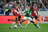 FUSSBALL   1. BUNDESLIGA   SAISON 2012/2013   3. SPIELTAG Hannover 96 - SV Werder Bremen     15.09.2012 Lars Stindl (li) und Steven Cherundolo (re, Hannover 96) gegen Eljero Elia (Mitte, SV Werder Bremen)