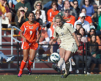 Boston College midfielder Kate McCarthy (21) passes the ball. .After two overtime periods, Boston College (gold) tied University of Miami (orange), 0-0, at Newton Campus Field, October 21, 2012.