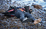 The body of a refugee child lies on a beach on the Greek island of Lesbos on November 1, 2015. The body appeared to be that of an Afghan boy of about 8 years of age. Thousands of refugees have died this year attempting to cross the Aegean from Turkey to Greece. Fleeing violence in Syria, Iraq, Afghanistan and elsewhere, most are on their way toward western Europe.