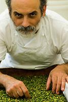 Portrait of confectioner Corrado Assenza selecting Bronte pistachios for whom he is the ambassador