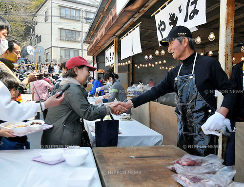 April 14, 2011, Ishonomaki, Japan - Japanese actor Tetsuya Watari, right, of Ishihara Promotion shakes hands with a quake victim as he and fellow actor Testsuya Watari run a soup kitchen in Ishonomaki, Miyagi Prefecture, on Thursday, April 14, 2011. The two big stars led Ishihara Promotion in providing meals for one week for the victims of March 11 earthquake and tsunami in this northeastern Japanese town. (Photo by AFLO) [3620] -mis-
