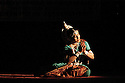 A woman performs a traditional dance from the state of Orissa at a venue in Varanasi, India.