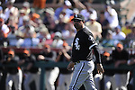 SCOTTSDALE, AZ - MARCH 09:  Manager Ozzie Guillen #13 of the Chicago White Sox makes a pitching change against the San Francisco Giants on March 09, 2011 at Scottsdale Stadium in Scottsdale, Arizona. The Giants defeated the White Sox 4-2.  (Photo by Ron Vesely)