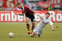 FUSSBALL   1. BUNDESLIGA  SAISON 2011/2012   22. Spieltag 1 FC Nuernberg - 1. FC Koeln       18.02.2012 Alexander Esswein (li, 1 FC Nuernberg) gegen Sascha Riether (1. FC Koeln)