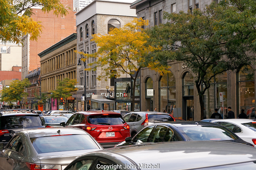 Traffic congestion on Rue Sainte-Catherine or Saint Catherine Street in downtown Montreal, Quebec, Canada