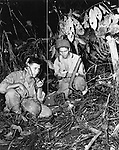 "Navajo Indian ""Code Talkers"" using a radio to commmunicate in theri native language on Bourgainville."