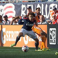 New England Revolution defender Kevin Alston (30) battle for the ball.  In a Major League Soccer (MLS) match, the New England Revolution (blue/white) defeated Houston Dynamo (orange), 2-0, at Gillette Stadium on April 12, 2014.