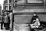 Derry The Northern Bank Ltd. Lunch time customers trying to get it  the bank for security reasons only a few are allowed in at a time . 1979. ..