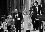 United States President Ronald Reagan and first lady Nancy Reagan attend one of the Inaugural Balls in Washington, DC on January 21, 1985.<br /> Credit: Howard L. Sachs / CNP
