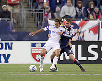 Kansas City Wizards midfielder Josh Wolff (16) traps the ball while closely defended by New England Revolution defender Chris Tierney (8). The New England Revolution defeated Kansas City Wizards, 1-0, at Gillette Stadium on October 16, 2010.