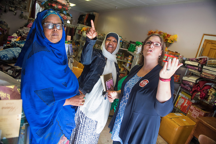 UNITED STATES - SEPTEMBER 08: Emily Cain, right, Democratic candidate for Maine's 2nd Congressional District, talks with immigrants including Fatuma Hussein, center, from Somalia, in Lewiston, Maine, September 8, 2016. (Photo By Tom Williams/CQ Roll Call)