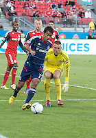 12 September 2012:  Chicago Fire midfielder Pavel Pardo #17 and Toronto FC goalkeeper Milos Kocic #30 in action during an MLS game between the Chicago Fire and Toronto FC at BMO Field in Toronto, Ontario..The Chicago Fire won 2-1..